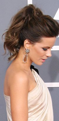 Tease hair in front and pull into ponytail
