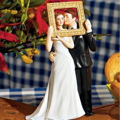 super cute - too bad I already have my cake topper! Romantic Couple Wedding Cake Topper by Beau-coup