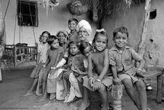 An elderly couple from the Banjari tribe with their grandchildren near Hyderabad, India, in 1985.