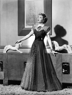 Claudette Colbert- striped evening gown - late thirties or early forties.  She was the epitome of class.