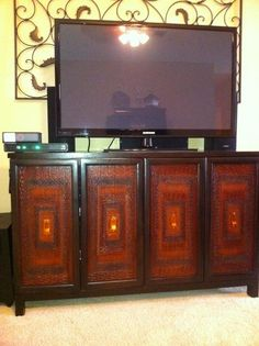 Pier 1 Terracotta Low Cabinet used as a TV console