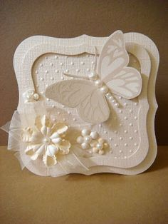 handmade card ... white on white ... square labels ... embossed white butterfly cut out with pearl body ... lovely ...