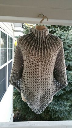 Hot Off My Hook! Project: Cowl-Neck Poncho Started: 21 Oct 2015 Completed: 24 Oct 2015 Model: Madge the Mannequin Crochet Hook(s): 7mm, Cowl portion J, Granny Stitch Yarn: I Love This Yarn Color(s): Gray Mist, Cappadocia Pattern Source: Simply Crochet Magazine Issue No. 25 Pattern Designed By: Simone Francis Notes: This is my 40th Cowl-Neck Poncho! I was inspired by the gray sky as the seasons change.