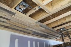 As you know, we've been working on disassembling pallets off and on for quite some time now. We've finally started installing some of the pallet ceiling. We haven't done too muc… Basement Makeover, Basement Renovations, Home Remodeling, Basement Ideas, Dark Basement, Basement Plans, Garage Ideas, Wooden Pallet Crafts, Wooden Pallets