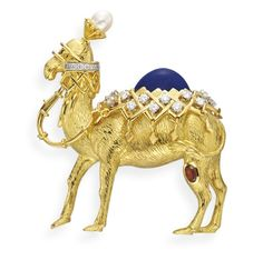 A GOLD, MULTI-GEM AND ENAMEL CAMEL BROOCH, BY JEAN SCHLUMBERGER, TIFFANY & CO. Designed as a textured 18k gold camel with a cultured pearl headdress, and a lapis lazuli hump, accented by circular-cut diamond and gold blanket and harness, the leg enhanced by a bezel-set oval-cut garnet, mounted in 18k gold, in a Tiffany & Co. black suede case