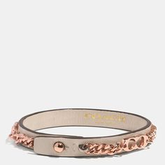 Cast in brass with a precious metal plating, a polished chain and Signature Cs make a distinctive wrist accent paired with a leather band. Hand-finished edge painting and a simple, elegant push closure lend this bracelet an artisanal finish.
