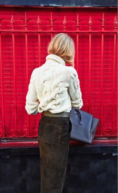 Cable knit turtleneck tucked into a brown suede skirt. // SHOP THE LOOK HERE