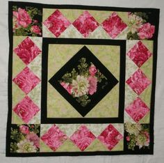 pretty quilt love this one colours are georgous.