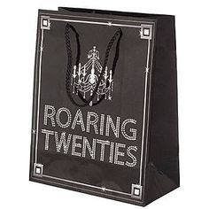 Our Roaring Twenties Gift Bag features a design of a crystal chandelier and the words ROARING TWENTIES imprinted on a black glossy back.