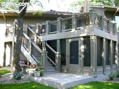 With a solid gray color scheme and heavy posts, this elevated deck with under deck screen room is a stand-out project.