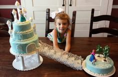 "A labor of love for my sweet Jaimalyn on her 4th birthday!  Good think I kept all the ""old timey"" wedding steps and pillars! she special ordered all the features right down to the door on the castle and snowflake in Queen Elsa's hair!"