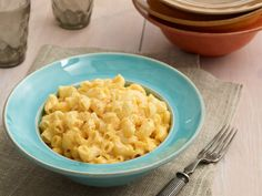 Slow-Cooker Macaroni and Cheese : Using low heat allows the cheese to melt completely in the pasta and gives you the best plate of mac and cheese you've ever had.