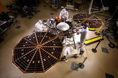 The solar arrays on NASA's InSight lander are deployed in this test inside a clean room at Lockheed Martin Space Systems, Denver. This configuration is how the spacecraft will look on the surface of Mars. Image Credit: NASA/JPL-Caltech/Lockheed Martin