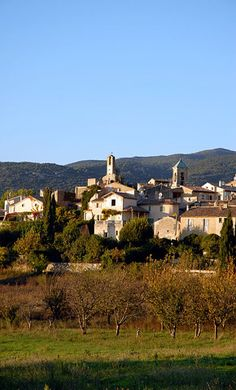 Lourmarin in southern France. At the centre of the skyline is the 17th century belfry and clock, keeping time for a village whose roots extend back over a thousand years. (There is evidence that the area was inhabited even earlier, in the Neolithic Age some 12,000 years ago.) Today's clock was built atop a fortified 11th century watchtower. The steeple of Saint-André et Saint-Trophime Church can be seen to the right.