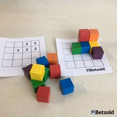 A lot can be done with the small, colorful wooden cubes. For example… - Bildung Learning Games For Kids, Activities For Boys, Kindergarten Math Activities, Preschool Math, Montessori Art, Busy Boxes, Wooden Cubes, Grande Section, Maths Puzzles