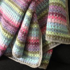 Simple block stitch blanket with lovely soft colors.