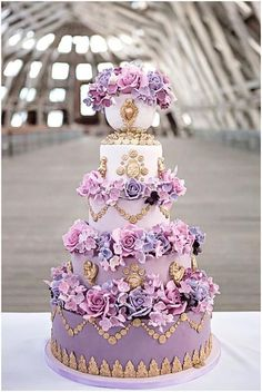 Regal purple wedding cake and Gold trim