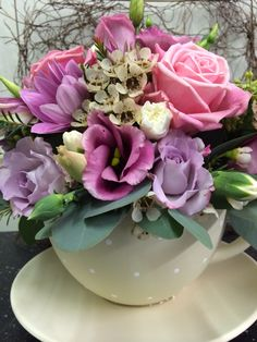Tea cup arrangement - pinks and lilacs - cute polka dot and lace tea cup #pennyjohnsonflowers