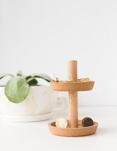 If you need a fashionable place to place some loose jewelry then come and visit Paper & Stitch for the quick and easy DIY for this Two Tier DIY Jewelry Stand…it costs under $10 to make!  This would make a great gift too!