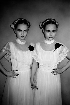 Prim witchy twins in white dresses and black talons