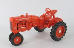 JLE Scale Models Allis-Chalmers CA Narrow Front tractor in 1/16 scale (7-1/2 in long ) die-cast. Made in USA. All metal except tires. Front wheels do not steer. Arizona Diecast & Models