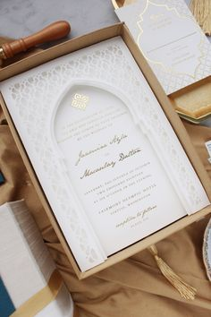 Custom Moroccan Styled Invitation in a Silk Wrapped Box. Elegant and refined, this Invitation Suite is printed in Gold Foil and features a laser cut paper stack and tassels! Pakistani Wedding Cards, Muslim Wedding Cards, Muslim Wedding Invitations, Indian Wedding Invitation Cards, Box Invitations, Arab Wedding, Wedding Invitation Card Design, Creative Wedding Invitations, Card Box Wedding