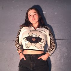 79029288f9d05 Vintage cream and thick cotton crop sweater featuring a teddy bear and  cheetah print along the sleeves. Zipper on front collar. www.depop .com Rodolfo1994