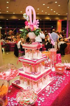 Delicious pink and white candy bar with favor bags tower. Wedding by Lasting Impressions.