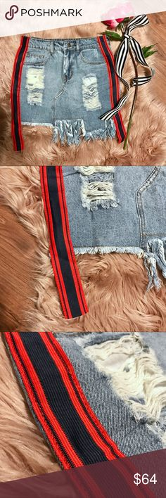 "✨NEW✨Athletic Stripe Denim Skirt BOUTIQUE ITEM Bundle 2+ items and get an automatic ✨20% Off!✨ Offers also welcome!  This trendy denim skirt features a raw, asymmetric frayed hem, destroyed detailing, and sporty red and navy blue striped ribbons up the sides. Button-zip fly, five-pocket construction, and small slit in the back for easier movement! Approx. 15.5"" long. Small is approx. jean size 26-27, Medium is approx. 28-29. Skirts Mini"