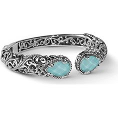 Carolyn Pollack 925 Sterling Turquoise Quartz Double Hinged Cuff Featuring Carolyn Pollacks signature silver work this cuff bracelet is one of designers most popular designs. The customer top rated style features sculptural details that shimmer and shine in textured and polished 925 sterling silver and two faceted doublets of turquoise and crystal quartz gemstones while an oxidized sterling silver with ropes and swirls design finish adds a touch of mystery. Each ends cap displays a brilliant…