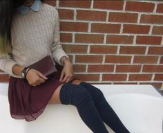 beige knitted sweater over denim collared shirt paired with burgundy skirt and knee high socks