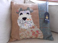 Applique Dog cushion  Pattern from Woman's Weekly magazine.  I bought the Harris Tweed on the Internet, it comes with labels!