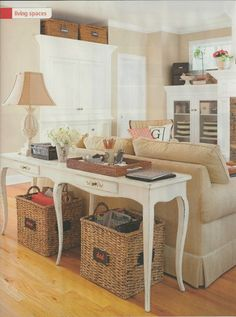 Creative use of a sofa table for an entryway table as well.