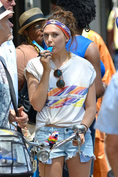 Elizabeth Olsen stopping for a sweet treat,colors her lips blue with chewy candy.