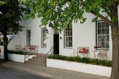 A hotel landmark in the heart of Stellenbosch, wine capital, university town and 'living museum', Oude Werf blends its colourful Georgian origins as one of South Africa's very first inns, with luxury and Century comfort. Bed And Breakfast, Places Ive Been, Places To Go, Cape Colony, Hotel Boutique, Cape Dutch, Georgian Architecture, South Africa, Trip Advisor