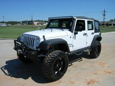 "2012 Jeep Wrangler Unlimited Sport with a 4"" Rancho lift, White powder coated metal wheels, 30"" Toyo Mud Terrain Tires, 50"" Rigid Industry Windshield light and Fog lamps, check out the other options at http://peterscars.com/2012-Jeep-Wrangler-Unlimited-Sport-Longview-TX/vd/10560125"