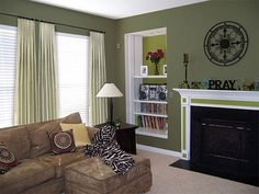 Living room with sage green paint colors - Maybe a wall in the bathroom with a lighter version opposite?