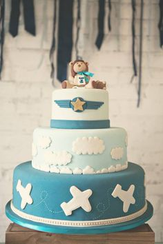 Aviator Bear Baby Shower By Silvia Roveri Eventos A stunning Baby Shower with the most simple , striking and unique touches such as -The Bold Navy ribbon bunting backdrop -Wooden toy aeroplan… Baby Cakes, Baby Shower Cakes, Décoration Baby Shower, Jordan Baby Shower, Airplane Baby Shower, Shower Bebe, Baby Shower Parties, 1st Birthday Themes, Baby 1st Birthday