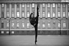 Russian Ballerina Hit The Sky by Little Shao, via 500px. Don't think it was an accident how her extended leg is positioned against the building in the background.