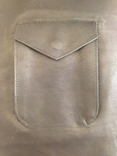 Leather Pocket Detail - sewing inspiration; creative pattern cutting; close up fashion details
