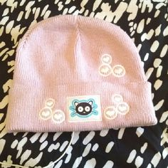 Hat with Built-in Headphones *NWOT* This light pink hat has a cat graphic and hearts embroidered on the front, but the greatest feature is the built-in headphones! Just plug your iPod into it! Great for walking and running... No annoying headphones to fall out of your ears! Also makes a great gift! It has never been worn or used, and the cord is still wrapped up as it was originally, but I did plug it into my laptop to confirm it worked before creating this listing. Accessories Hats