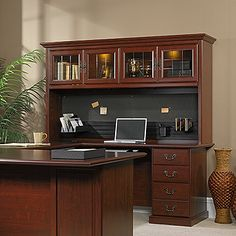 Hutch attaches only to  Executive Desk 109843  with  48 in. Return Kit 109848  and optional  72 in. U-Shaped Connector Kit 109872 .  Hutch WILL NOT attach to the executive desk alone.   Two display lights behind framed door with etched, safety-tempered glass.  Fabric-covered memo corkboard.  Slat wall section includes CD holder, pencil cup and folder sorter tray.  Classic Cherry finish.