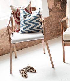Shop Latitude, leopard slippers, pillows, chevron, wood chair / Garance Doré