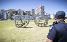 Very Sad: Recently the huge, Mandela-inspired Ray-Ban art installation was defaced by a group so-called activists, who call themselves 'Tokolos'.  Read more: http://www.2oceansvibe.com/2014/11/18/new-mandela-inspired-art-installation-doesnt-even-last-a-month/#ixzz3Tw2yPV1W