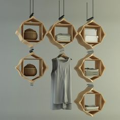 I bet I could make something like this with wooden hangers.  Fancy - Hang On Storage System by Pog Architecture