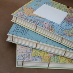 Look a these gorgious handmade journals. You'd almost wish you were a captain in unknown waters...