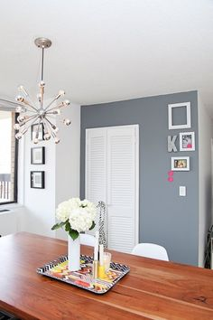 Before & After: A Fresh, Flexible & Fun Family Apartment — Professional Project. Perfect gray wall plus a Sputnik light over a nice dining table in this bright New York City apartment for a family!