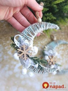 Frosted twine moon with snowflake and greenery ornamentThese little crescent moon decorations are so easy and festive.Christmas Songs In Yoruba Language Christmas Gifts For Sports diy christmas ornaments that bring the joy homelovr – Artofit Diy Christmas Ornaments, Christmas Projects, Handmade Christmas, Holiday Crafts, Christmas Wreaths, Angel Ornaments, Christmas Tree Toy, Christmas Holidays, Christmas Music