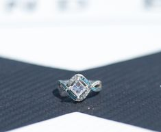 Custom 1 ct. moissanite engagement ring with turquoise inlay.