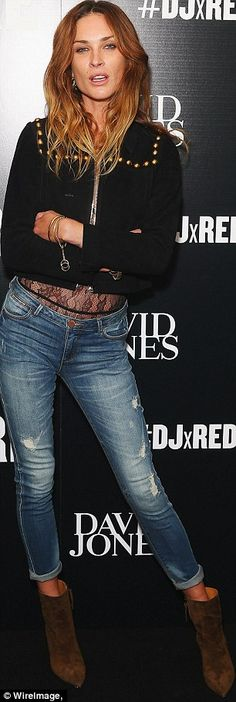 Working the denim! Stepping out in faded jeans, the actress teamed it with a sheer and plu...